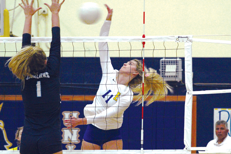 Teagan Bryant hits a kill down to the floor during the first set. Photo by Patrick Dillon.