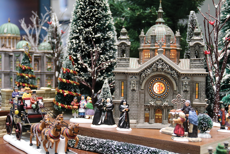 A Holiday in the City, a collection of holiday porcelain buildings, figures on display at TCOE